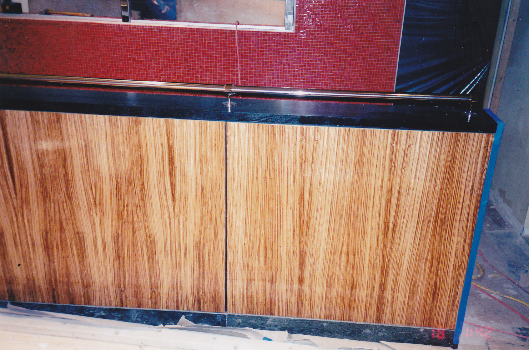 zebrawood veneered partition installed