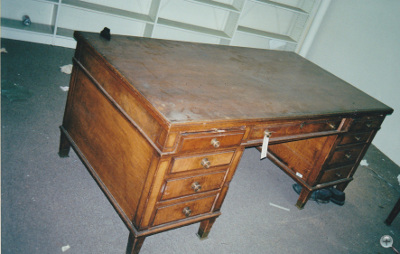 Walnut Double Pedestal Desks before Restoration. Typical Government issue desk from early 1900's