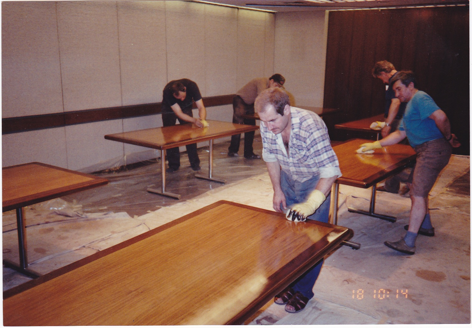 Conference room tables being refinished on-site