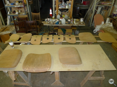 Eames Lounge Dining and Lounge Chair shells after removal of finish