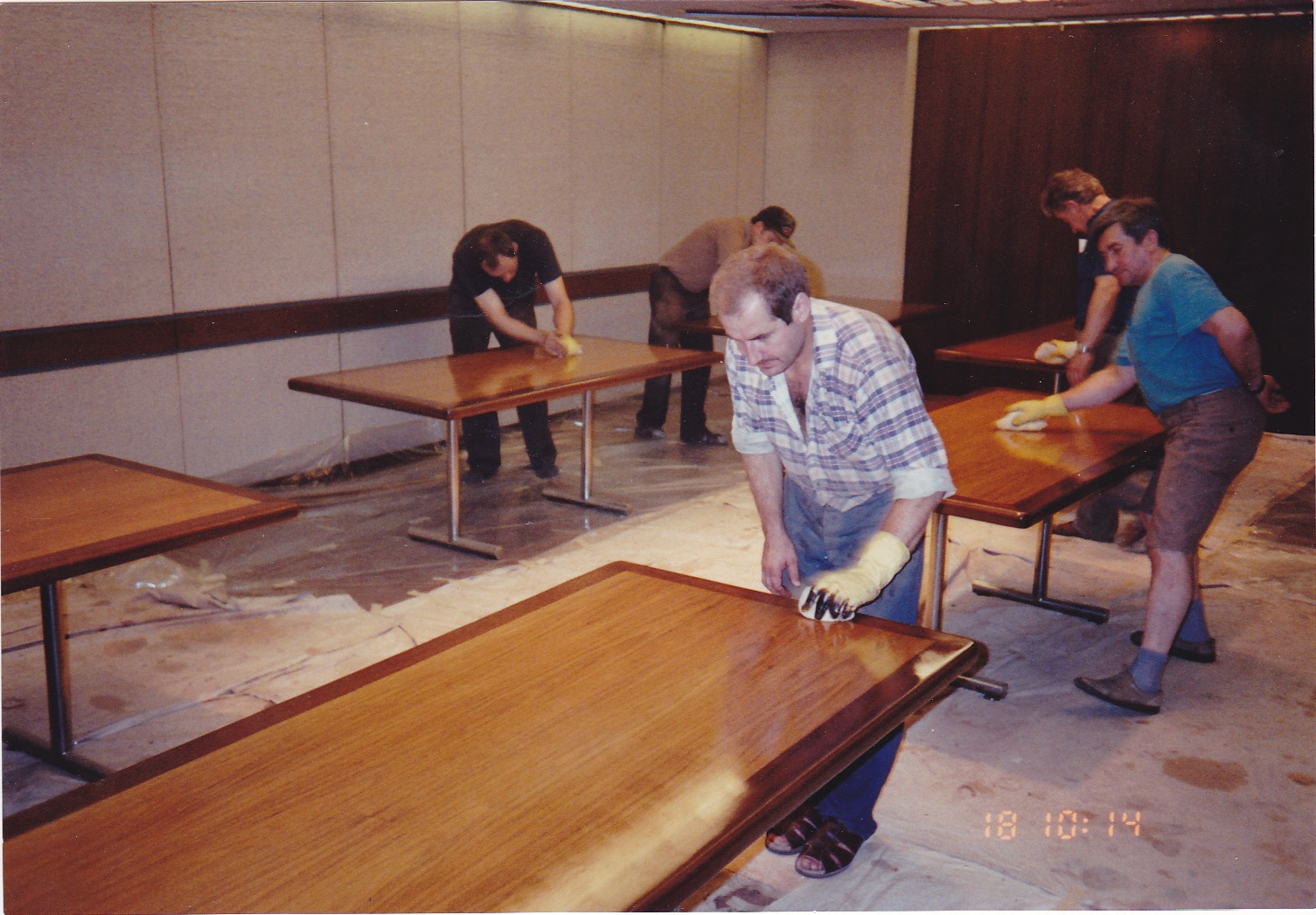On site Refinishing of modular conference tables, and restoration of top executive furniture