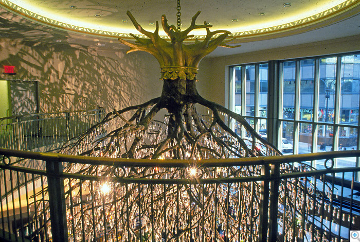 The sculpture, a 25 feet diameter x 30 feet high chandelier in the form of an upside down tree