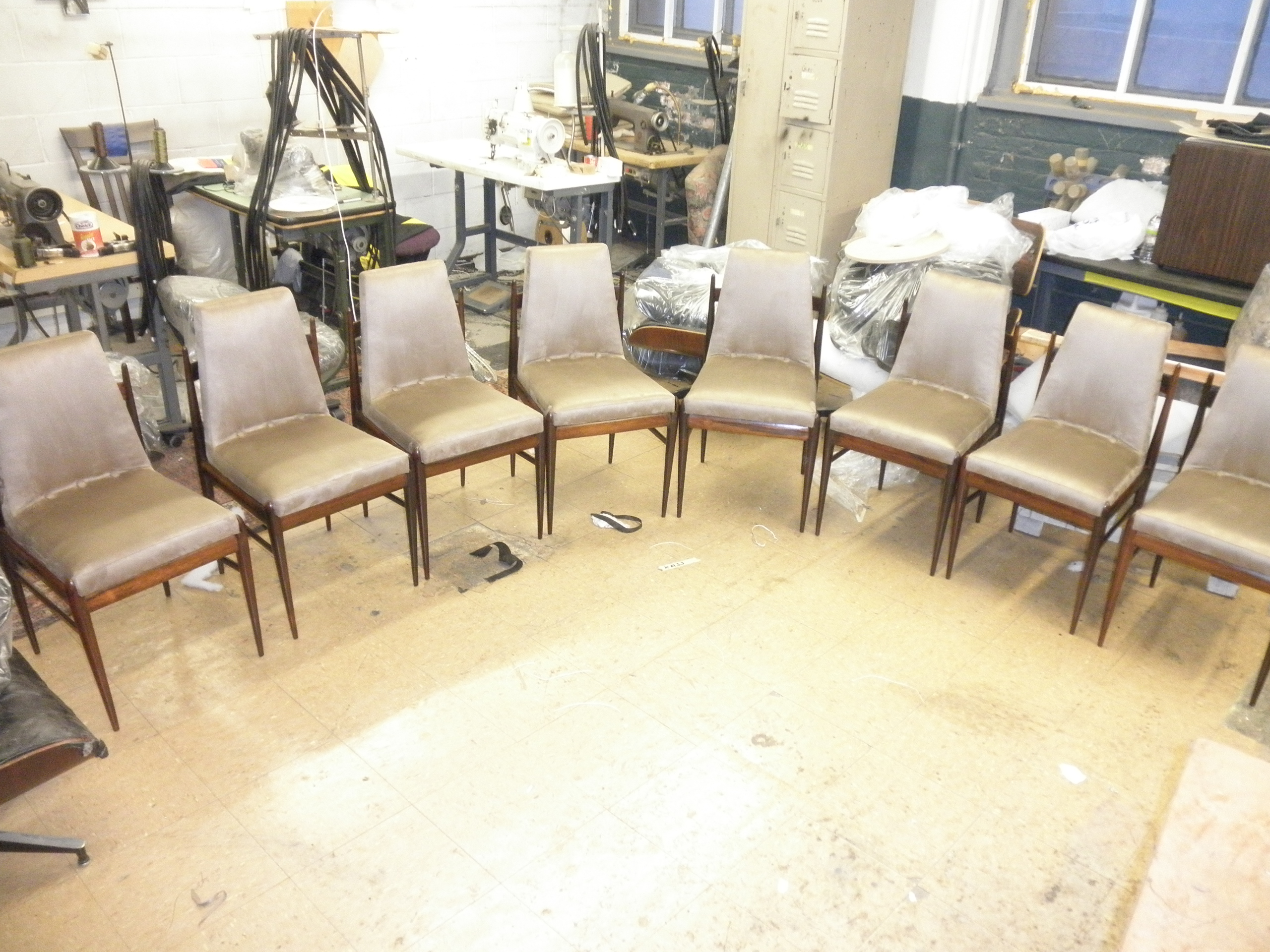 These chairs have been refinished, with the rosewood lightly sanded, selectively to match the color of the various parts.
