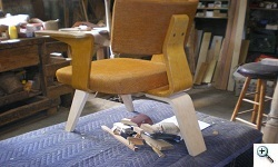 Vladimir Kagan tri-legged chair with newly fabricated replicas of parts