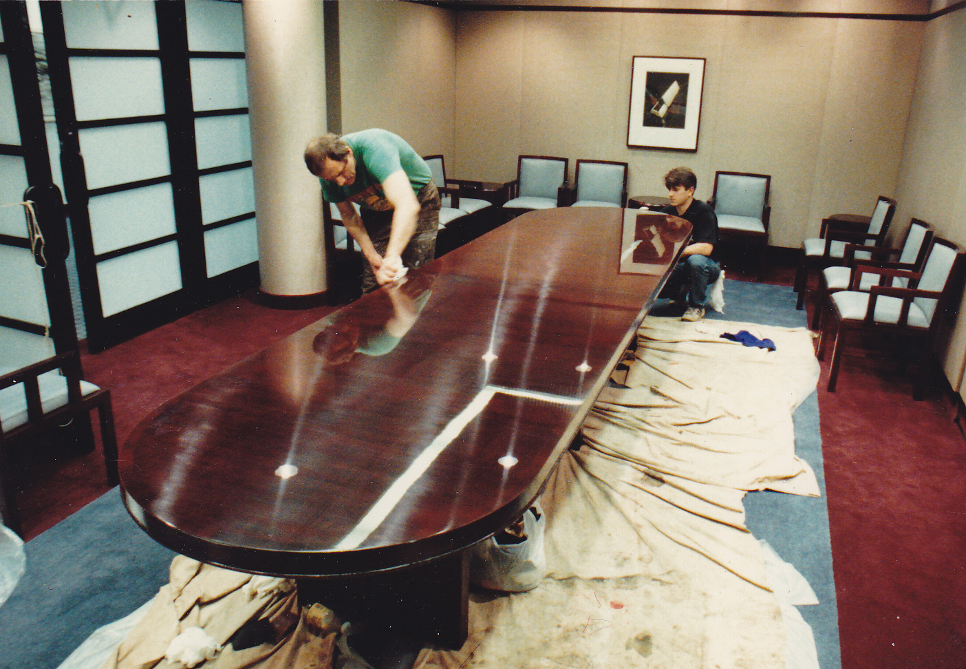 Conference table DURING refinishing and restoration ON SITE