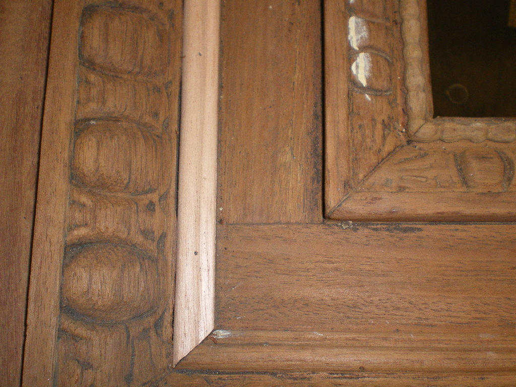 Original detail on door before restoration