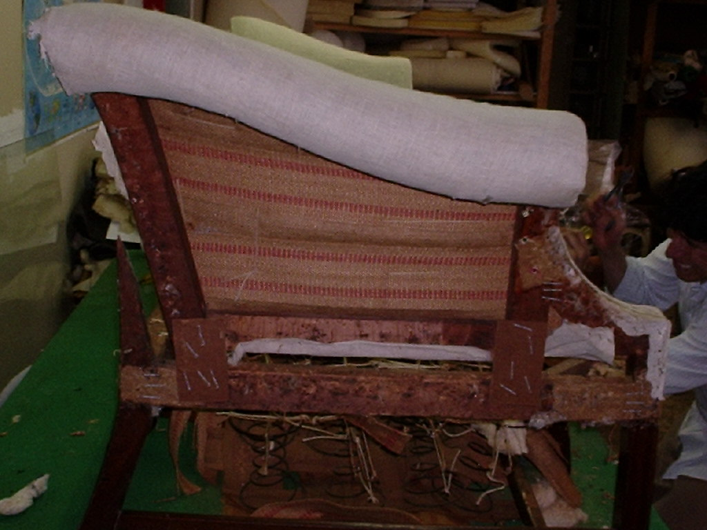 Side angle Queen Anne Period Sofa during restoration, NYC