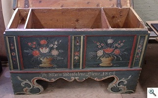 Front of Pennsylvania Dutch chest after conservation of milk paint finish