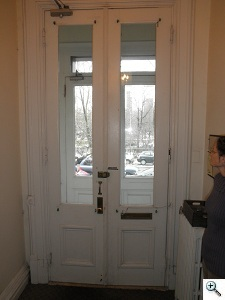 Restoration of Walnut Brownstone Entry Doors Before