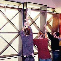 Installation of ebonized oak and stainless steel doors, for wine storage, during