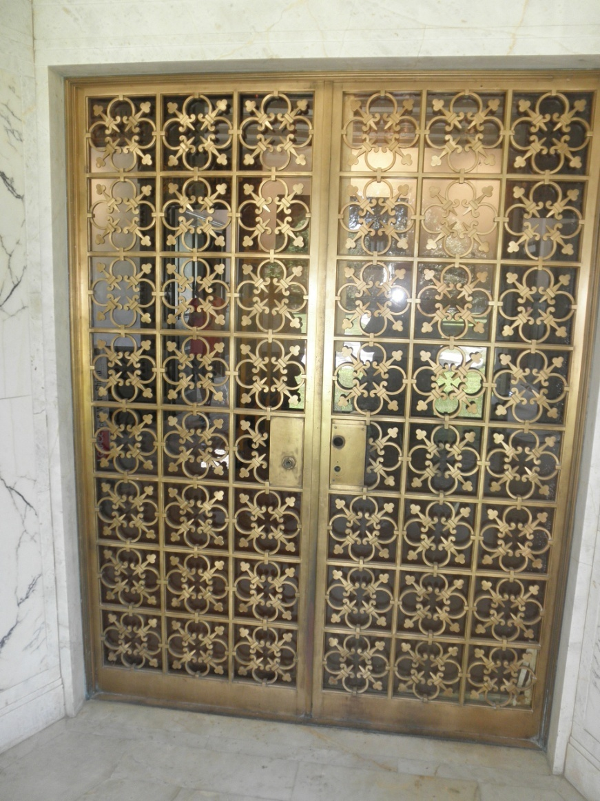 Solid bronze entry door had molding elements cut away to install closer & Fabrication and Restoration of Historic Iron and Bronze Doors ... Pezcame.Com