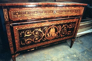 Chest had intensive losses of marquetry and loose veneer, caused by shrinkage across the grain of the underlying carcase.