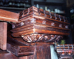 Over a century of use, resulted in heavy losses of applied moldings and decorative carved woodwork