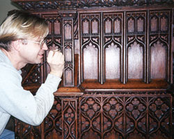 Cutting of matching knives to recreate moldings, carving missing elements and skillfully inlaying to match original design